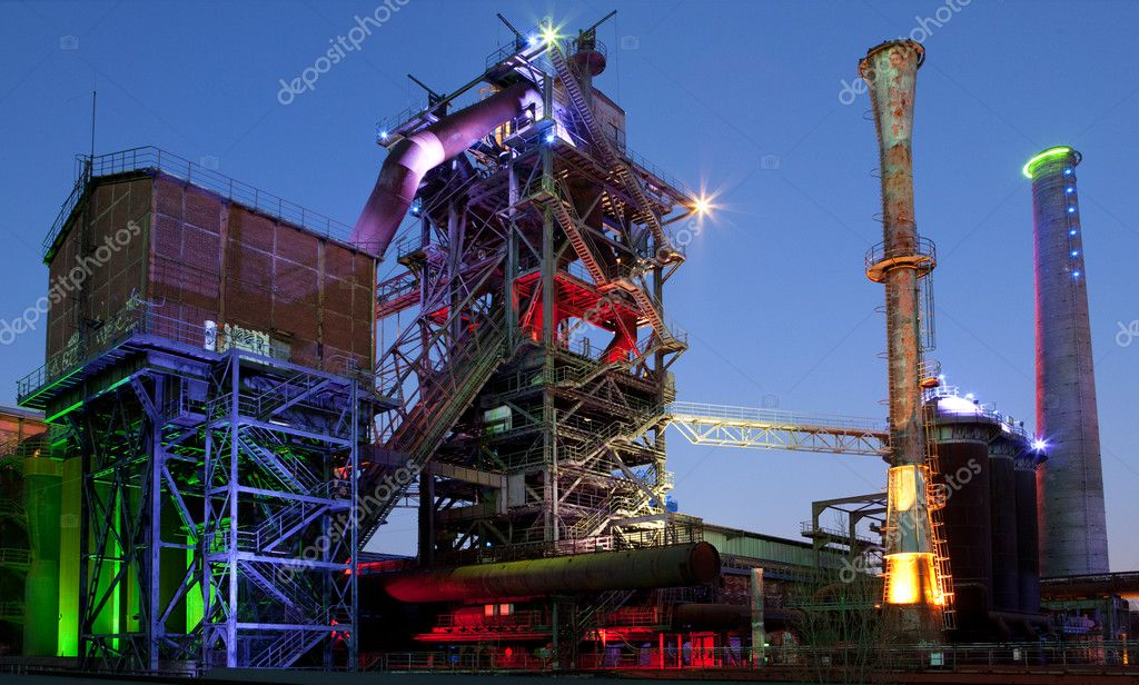 Steel industry blast furnace factory or plant abandoned old industrial architecture at night with colored lights Landschaftspark Duisburg, Germany — Stock Photo #9017102