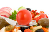 Cherry tomato on fork. — Stock Photo