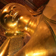 Stock Photo: Big golden Reclining Buddha