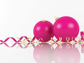 Pink Xmas balls and scrolls on white background — Stock Photo