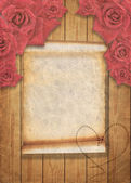 Aged vintage wedding background with red roses. — Stock Photo