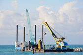 Port cranes work — Stock Photo