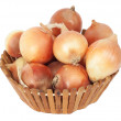 Mellow onions in wooden basket on a white background — Stock Photo