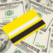 Yellow plastic card against dollar — Stock Photo #10247211