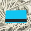 Stock Photo: Blue plastic card against dollar