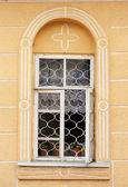 Open window with flowers — Stock Photo