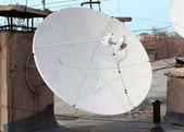 Satellite dish with sky on roof — Stock Photo
