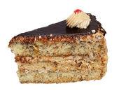 Fetta di torta alla crema con cioccolato su fondo bianco — Foto Stock