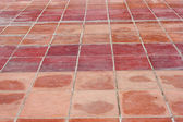 Perspective of Square red tiles floor — Stock Photo