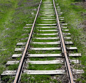 Old railway track on the morning hills landscape — ストック写真