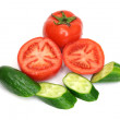 Tomatoes and cucumber isolated on white - Stock Photo