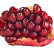 Extreme close up background of a red juicy ripe pomegranate frui - Stock Photo