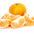 Slices of peeled orange on white background - Stock Photo