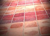 Perspectiva del cuadrado rojo azulejos piso — Foto de Stock