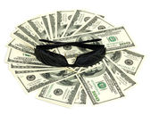 Black spectacles on background of the dollars — Stock Photo