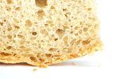 Korst van brood als achtergrond. macro — Stockfoto