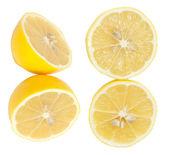 Fresh lemon halves on white background. — Stock Photo