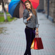 A shopping woman carrying shopping bags outdoor — Stock Photo #7977954