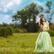 Portrait of a young beautiful woman on the nature — Stock Photo