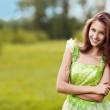 Portrait of a young beautiful woman on the nature — Stock Photo #7977989
