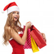 Stock Photo: Portrait of a Christmas woman in santa costume holding a shoppin