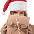 Happy Christmas woman holding gift wearing Santa costume — Stock Photo