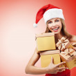 Happy Christmas woman holding gifts wearing Santa costume — Stock Photo #8029492