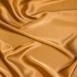 Smooth golden satin - Stock Photo