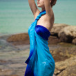 Beautiful woman in pareo on the tropical beach — Stock Photo