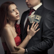 Young stylish couples and money — Stock Photo