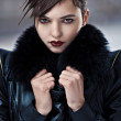 Stylish brunette womin leather coat — Stockfoto #9193259
