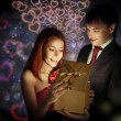 Happy man giving gift to his beloved — Stock Photo