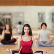 Stock Photo: portrait of healthy young woman practicing yoga on exercising ma