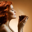 Stylish woman with an aromatic coffee in hands — Stock Photo #9193362