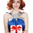 Young happy woman with a gift — Stock Photo #9193452