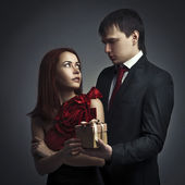 Man giving gift to his beloved. Romantic image — Stock Photo