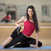 Portrait of healthy young woman practicing yoga on exercising ma — Stock Photo