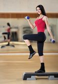 Young sporty woman in the gym centre. — Stock Photo