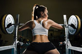 Sporty sexy woman in gym — Stock Photo