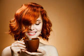 Stylish woman with an aromatic coffee in hands — Stock Photo