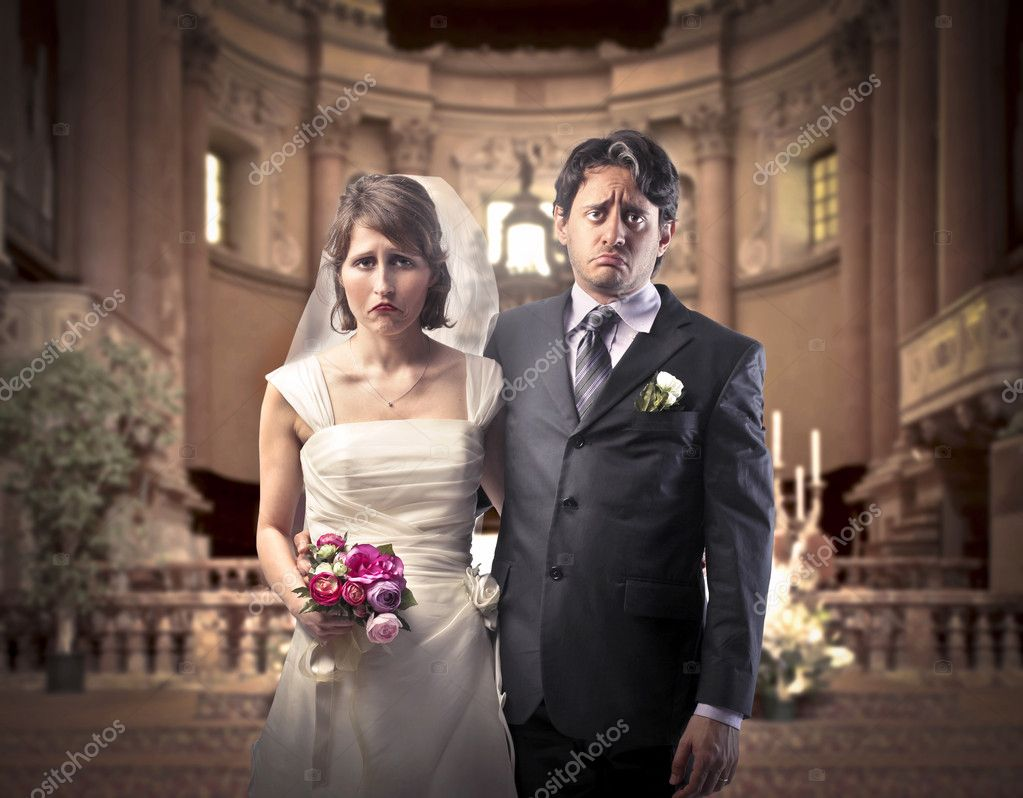 Sad marrying couple in a church — Stock Photo #10251589