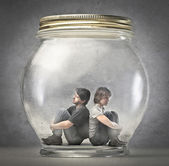 Man and woman sitting in a jar — Foto de Stock