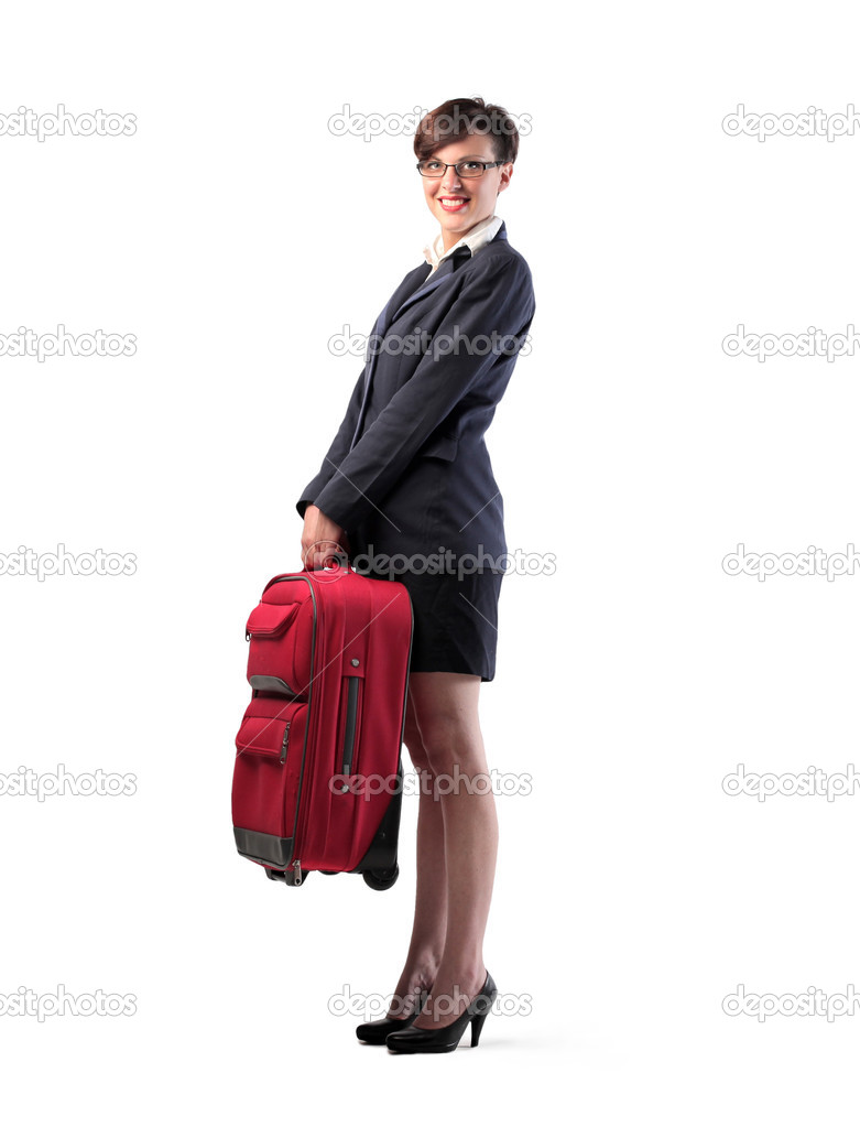 Isolated smiling businesswoman holding a trolley case — Stock Photo #10434248