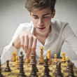 Stock Photo: Young man playing chess