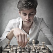 Young man playing chess — Stock Photo