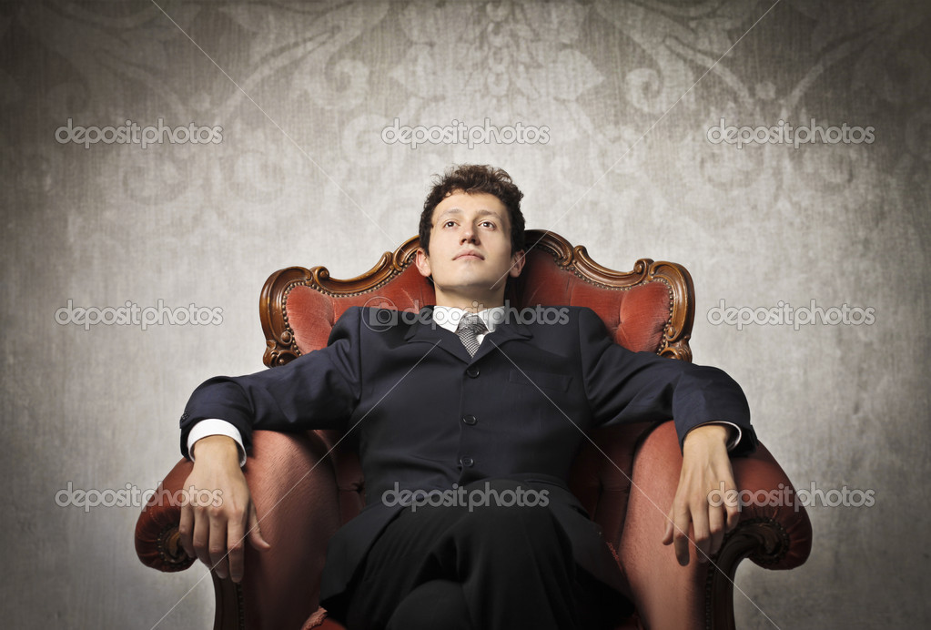 Young businessman relaxing on an armchair  Stock Photo #10515594