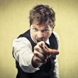 Angry man pointing his finger against somebody — Stock Photo