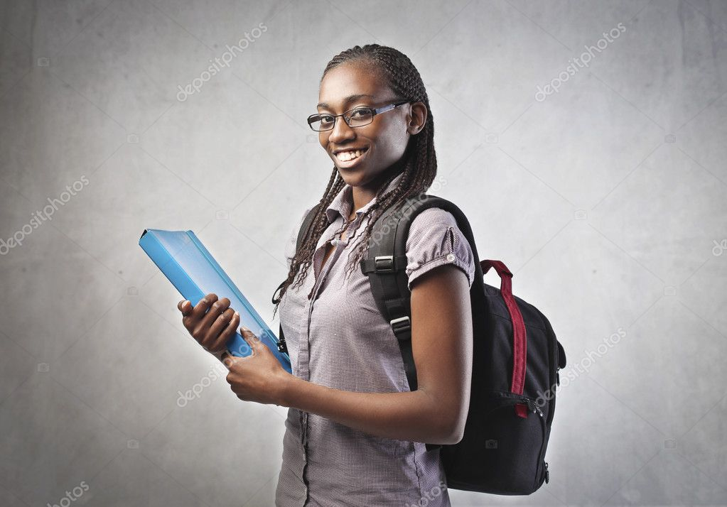 Smiling african student carrying a backpack and holding a folder — Photo #10627771
