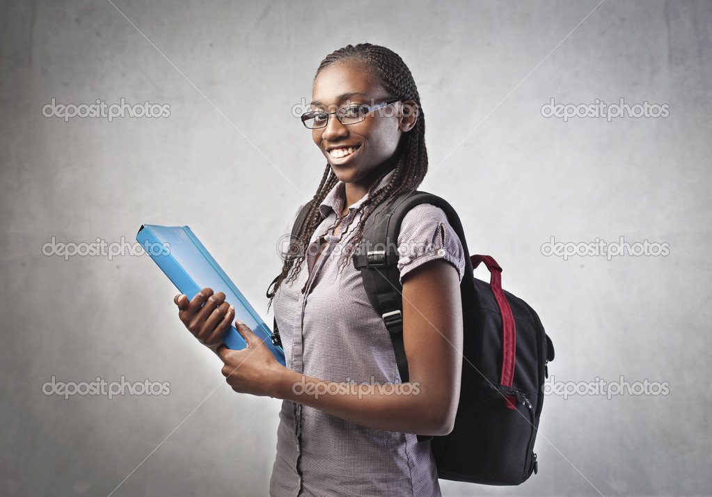 Smiling african student carrying a backpack and holding a folder  Stok fotoraf #10627771