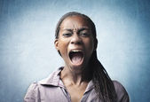 Angry young african woman screaming — Stock Photo